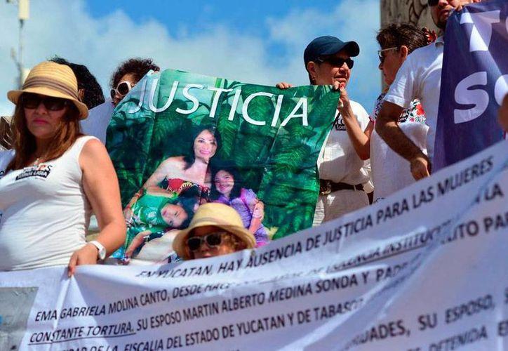 Aspecto de la protesta del pasado 11 de agosto, en la que varias organizaciones civiles exigieron la liberación de Ligia Canto, quien se encontraba detenida en Jalisco, acusada de fraude. La foto es de contexto (Archivo/Milenio Novedades)