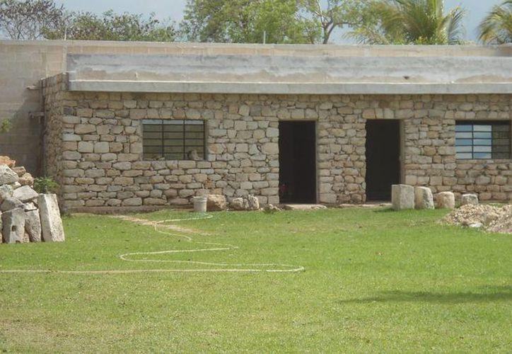 Vivienda cercana a un sitio maya. Fue construida, presumiblemente, con vestigios arqueológicos. (Fotos: Amílcar Rodríguez/Milenio Novedades)