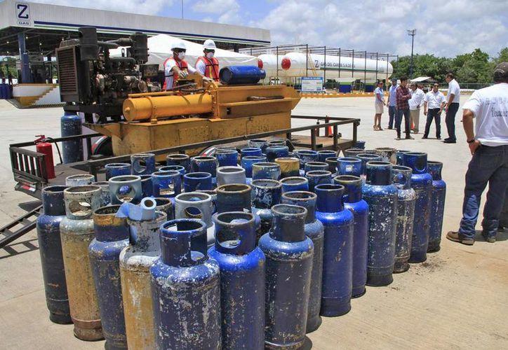 Las familias se preparan para un aumento mayor en cuanto se reactive el alza a la gasolina. (Foto: Jesús Tijerina/SIPSE)