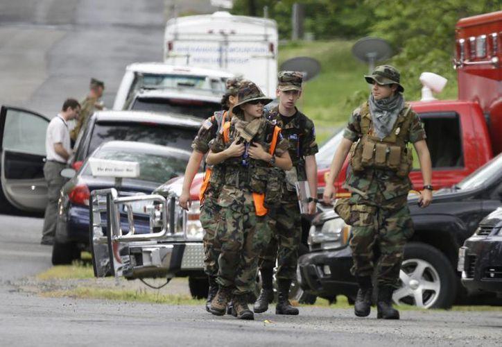La policía estatal indicó que el piloto del globo intentó apagar el fuego. (AP)