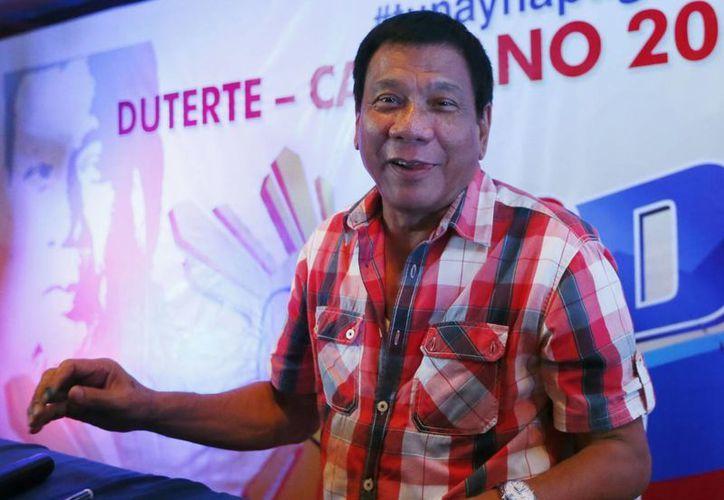 Rodrigo Duterte ha sido electo presidente de Filipinas tras concluir el conteo oficial de la votación realizada el 9 de mayo pasado.(AP Foto/Bullit Marquez)