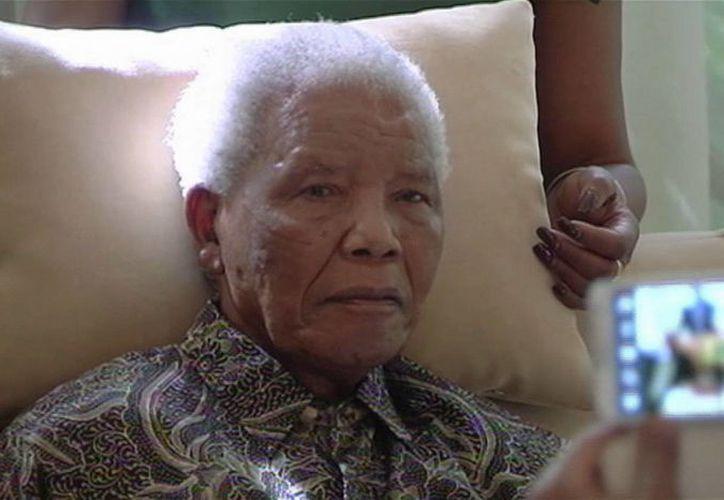 Mandela está estable pero su salud se ha visto mermada en los últimos meses. (Agencias)