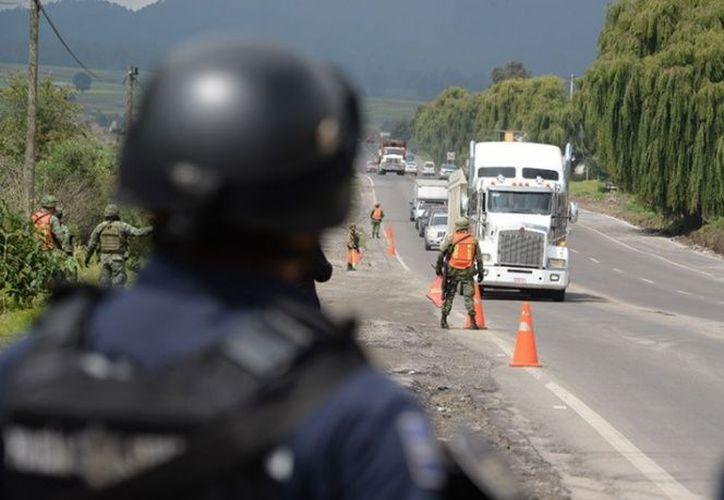La Policía Federal descubrió al grupo criminal que asaltaba camiones de carga. (Foto: Excélsior)