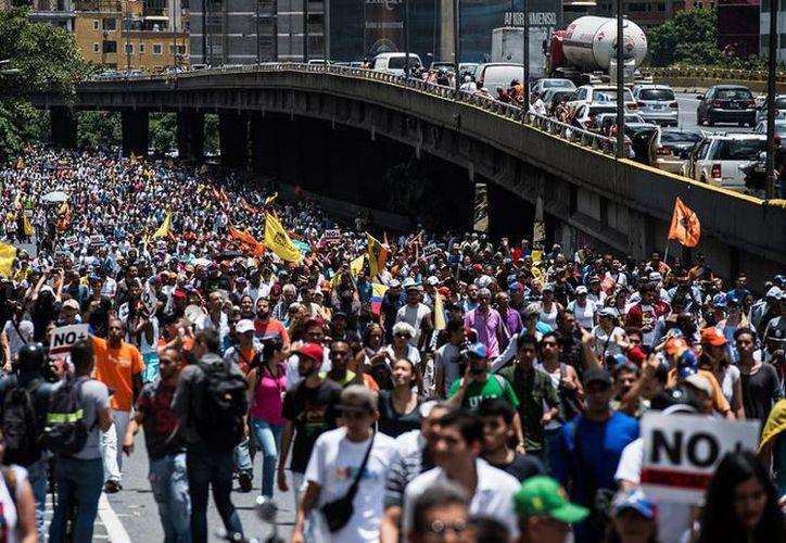 En la petición exhortan  al gobierno de Venezuela a dar cumplimiento al cronograma electoral. (AFP)