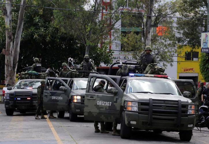 Con el apoyo decisivo del Ejército mexicano, autoridades federales lograron asumir la seguridad del sur michoacano. (Archivo Notimex)