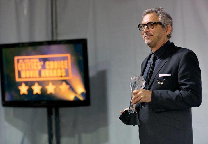 El cineasta mexicano Alfonso Cuarón sigue cosechando éxitos con su película <i>Grativy</i> (<i>Gravedad</i>): ayer ganó 7 premios de la Asociación de Críticos de Cine. (Agencias)