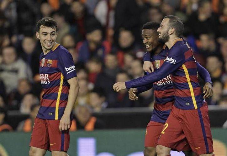 El Barcerona consiguió este miércoles un empate a uno en casa del Valencia, con lo que accedió a la final de la Copa del Rey tras golear en la ida con 7-0. (AP)