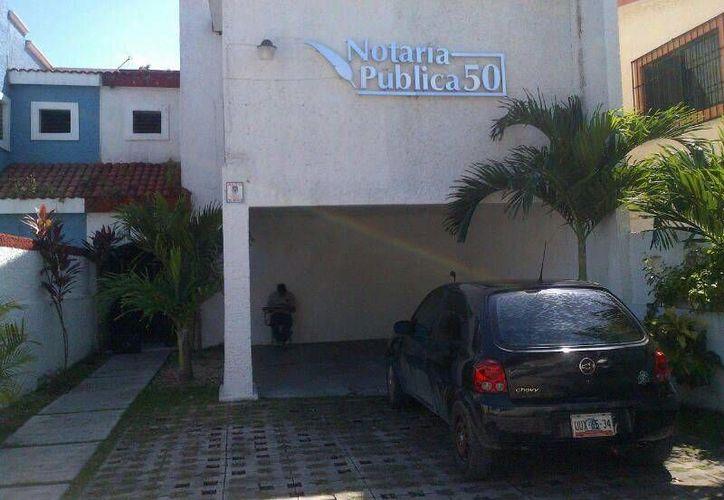 El encargado de la notaria pública informó que faltaban varias chequeras; aún no se contabiliza el total del robo. (Redacción/SIPSE)