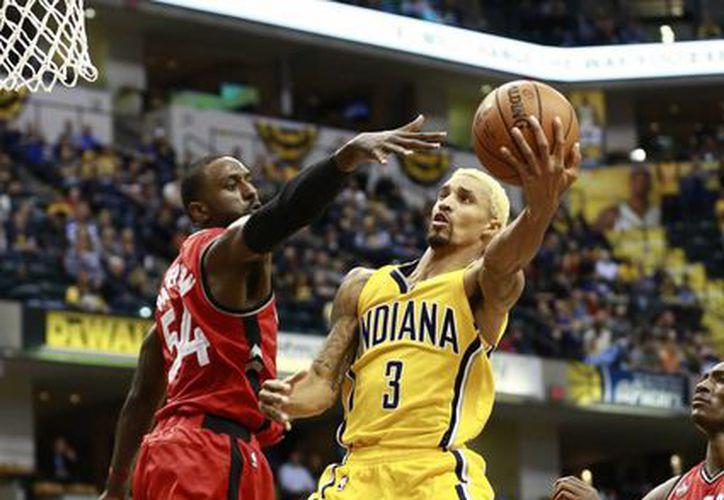 Jordan Hill encabezó la ofensiva colectiva que llevó esta noche a Pacers de Indiana al triunfo por 106-90 ante el visitante Raptors de Toronto, para llegar a 14 victorias por nueve derrotas en la NBA.- (AP)
