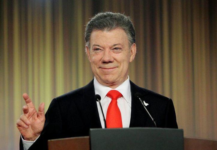Santos, que tomará posesión este 7 de agosto, tendrá que llevar a buen puerto los diálogos con la guerrilla. (EFE/Archivo)