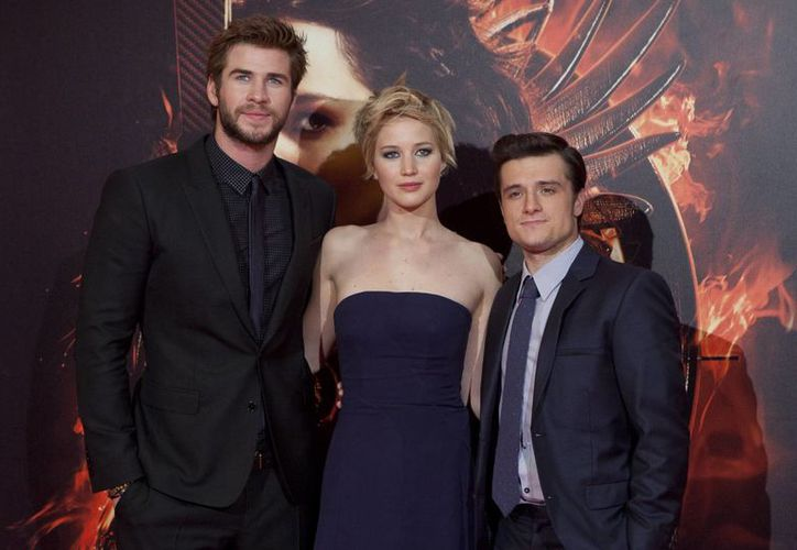 De i a d: Liam Hemsworth, Jennifer Lawrence y Josh Hutcherson, protagonistas de Los Juegos del Hambre: En llamas. (Agencias)