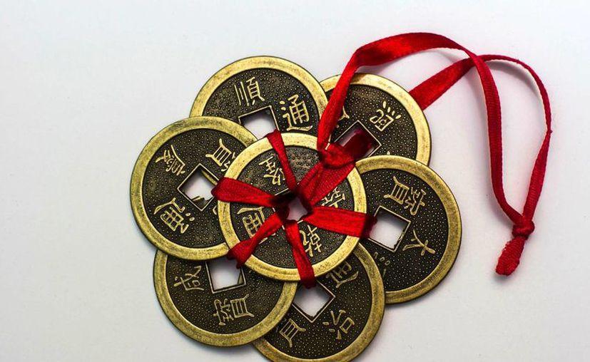 Las monedas chinas se tienen que llevar a todas partes para atraer la abundancia económica. (Imagen tomada de fengshuiconsulting.info)