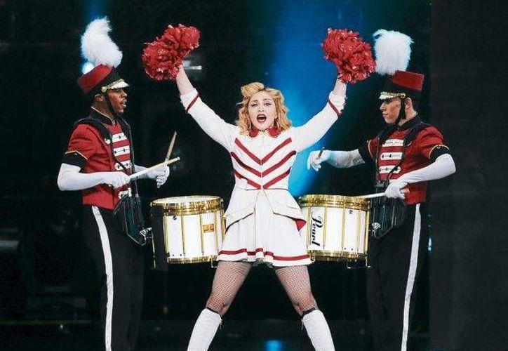 Madonna, quien será nombrada la mejor artista en giras, estará presente en el evento. (Internet)