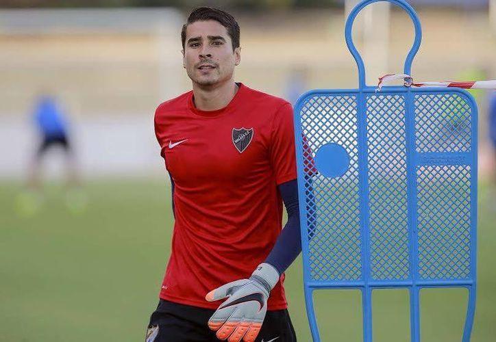 Guillermo Ochoa tomaría el lugar del Andrés Fernández, quien se marcharía al Villarreal en los próximos días. (Foto tomada de malagacf.com)