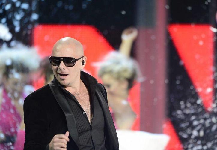El músico Pitbull es uno de los finalistas para Premios Tu mundo 2013. (EFE)