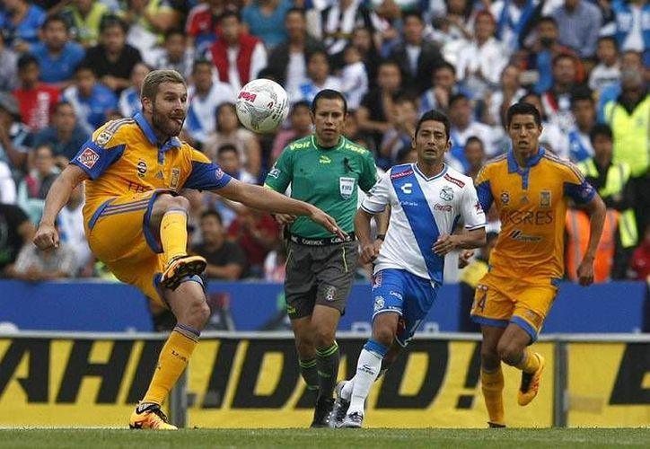 Aunque los Tigres contaron buena parte del partido con un jugador de más no pudieron vencer a La Franja, esto en duelo de la jornada 11 de la Liga MX. (Imágenes de la LIGA MX)