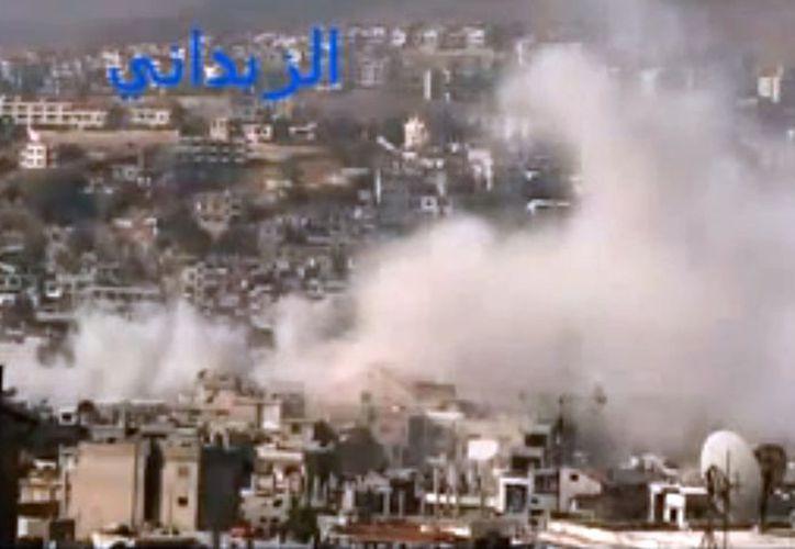 La lucha entre rebeldes y militares se ha extendido en Damasco (en la foto), capital de Siria. (Agencias)