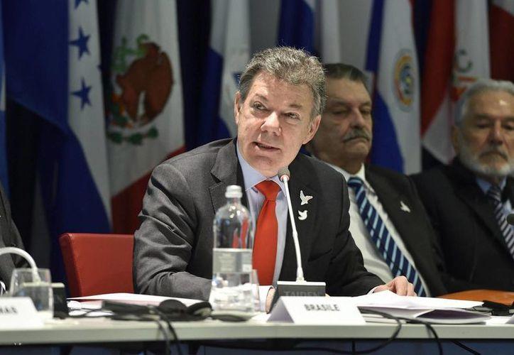 El presidente Colombiano, Juan Manuel Santos, aseguró que el rebelde muerto llevaba 35 años en las filas del ELN. (EFE/Archivo)