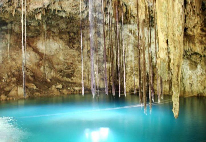 En el Cenote Maya se realizó un concierto sobre el agua. (Milenio Novedades)