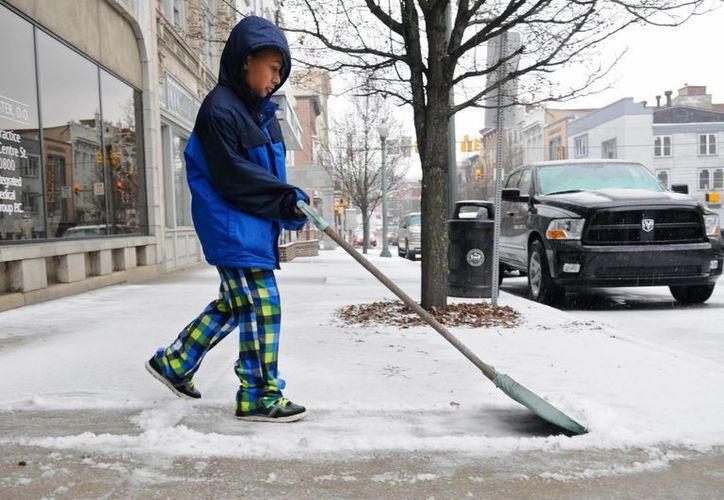 El Servicio Meteorológico Nacional también emitió una advertencia para los estados de Minnesota y Iowa, que podrían recibir hasta 30 centímetros de nieve. (Agencias)