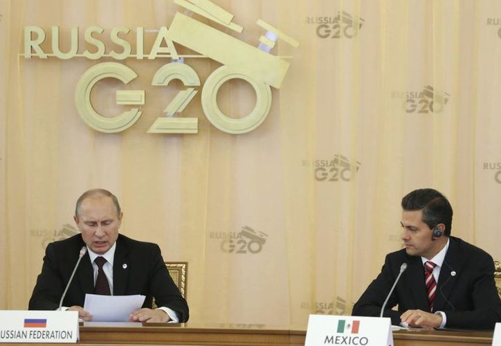 El presidente de Rusia, Vladimir Putin (i) y el de México, Enrique Peña, durante la Cumbre del G20. (Agencias)