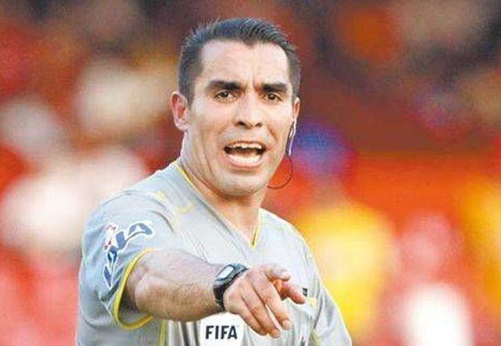 Marco Antonio Rodríguez ya fue silbante en Alemania 2006 y en Sudáfrica 2010, y en junio y julio de este año lo hará en la Copa Mundial de Brasil. (Mexsports.com)
