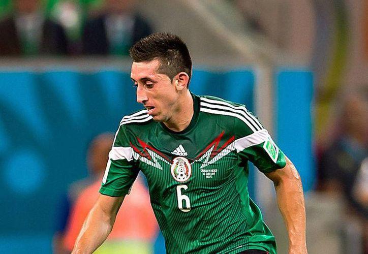Héctor Herrera fue titular con México en el Mundial de Brasil. (milenio.com)