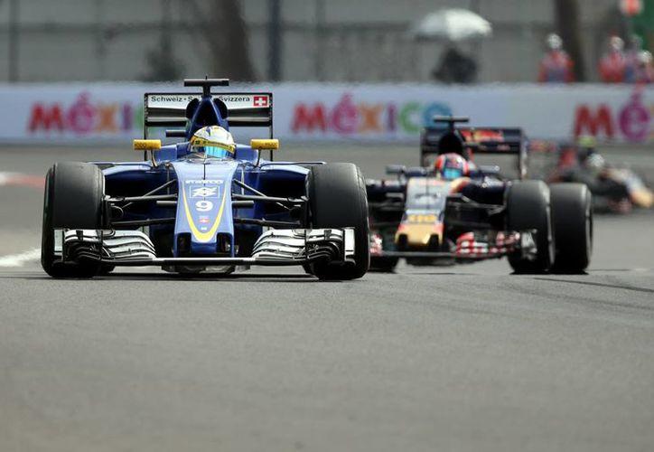 Este viernes dieron inicio las primeras actividades, en la que los pilotos realizaron pruebas de sus autos en el Hermanos Rodríguez.(Notimex)