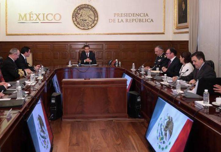 Aspecto de una reunión del presidente Enrique Peña Nieto con funcionarios de su gabinete, el 18 de mayo de 2015. Varios de ellos no han hecho pública su declaración patrimonial. (Archivo/Notimex)