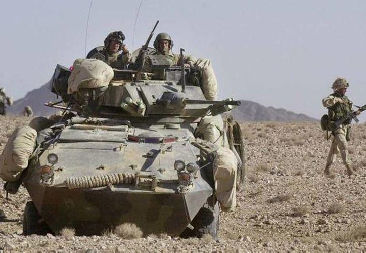 Las tropas que quedarán se distribuirán por todo Afganistán y se centrará en misiones antiterroristas y de entrenamiento de las fuerzas de seguridad afganas. No estarán involucrados en misiones de combate. (Archivo/Agencias)