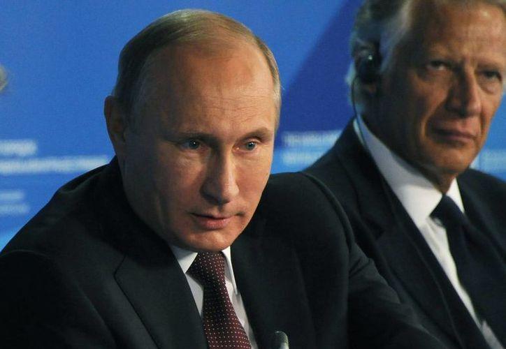 """""""Yo no voy a ocultar que ayudamos (a Yanukovich) a moverse a Crimea"""", sostuvo Putin en un discurso en el Club Valdai, en Sochi. (Agencias)"""