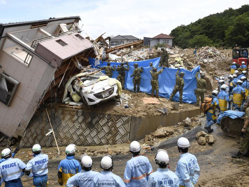 Rescuers conduct a search operation for missing persons in Kumano town, Hiroshima prefecture, western Japan Monday, July 9, 2018. (AP)