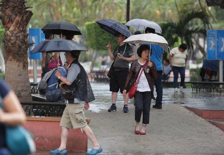 Existe un 80 por ciento probabilidad de chubascos fuertes con tormentas muy fuertes en Yucatán. (Archivo/Notimex)