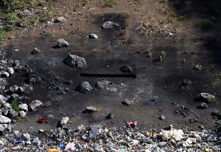 Una nueva investigación encabezada por la CIDH afirma que los estudiantes de Ayotzinapa no fueron incinerados en un basurero de Cocula. Imagen del sitio donde supuestamente quemaron a los normalistas en Cocula. (Archivo/AP)