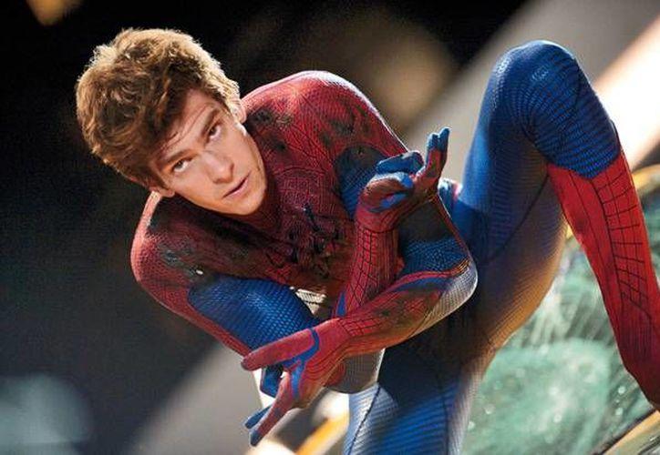 El Hombre Araña se ha enfrentado a diversos villanos en su carrera contra el crimen. En la imagen, el protagonista más reciente de las películas, Andrew Garfield. (Agencias)
