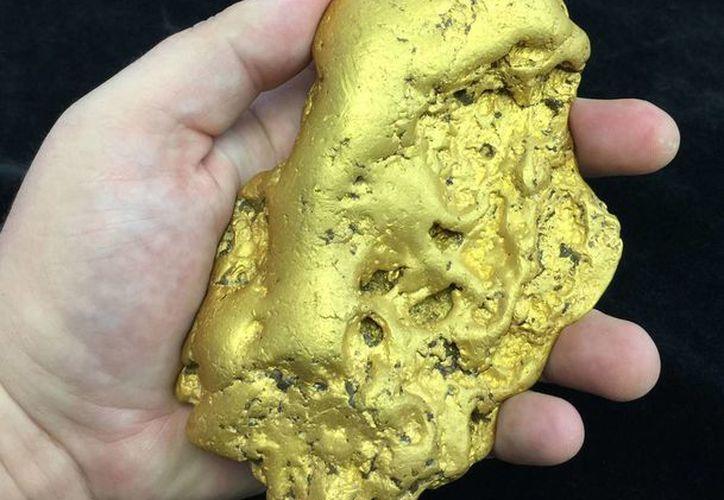 Imagen proporcionada por el subastador Don Kagine, de la pepita de oro 'Butte' que será puesta en subasta. (Foto: AP/Kagin's Inc.)