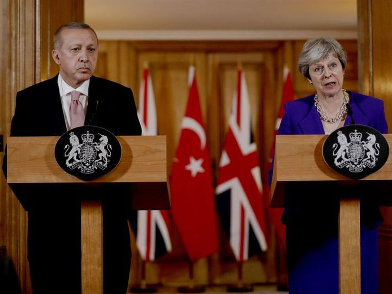 Turkey's President Recep Tayyip Erdogan, left and British Prime Minister Theresa May take part in a press conference after their meeting at 10 Downing Street in London.