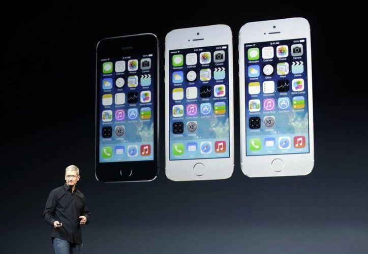 Tim Cook  dijo que tras el lanzamiento de los nuevo iPhones se vendieron 9 millones el primer fin de semana. (Agencias)