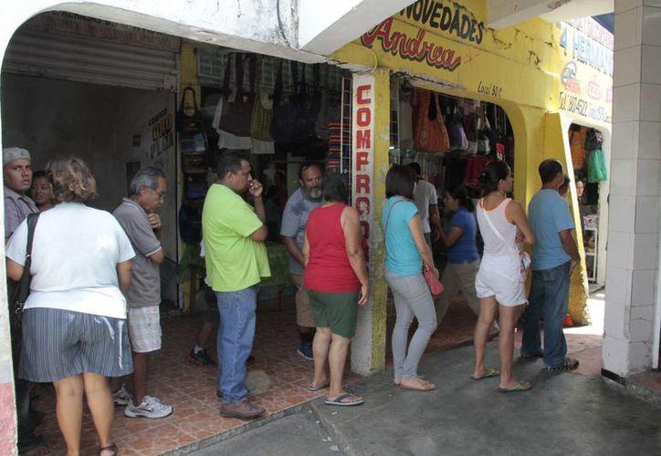 En el municipio, un total de 500 locales ubicados en los mercados de Cancún dejaron de ser propiedad del Ayuntamiento. (Tomás Álvarez/SIPSE)