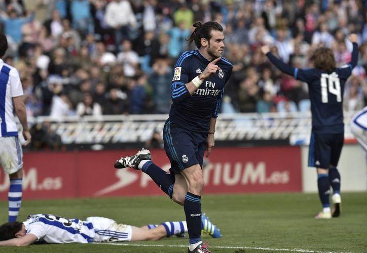 Gareth Bale(foto) fue el autor del gol del triunfo del Real Madrid, para ubicarlos en el liderato a espera de lo que hagan Barcelona y Atlético.(AP)