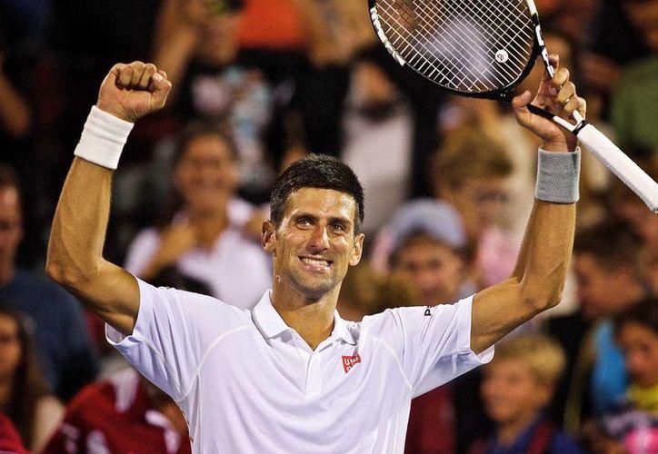 El serbio Novak Djokovic celebra su victoria el 14 de agosto de 2015 frente a Ernest Gulbis en el Masters 1000 de Montreal. (EFE)