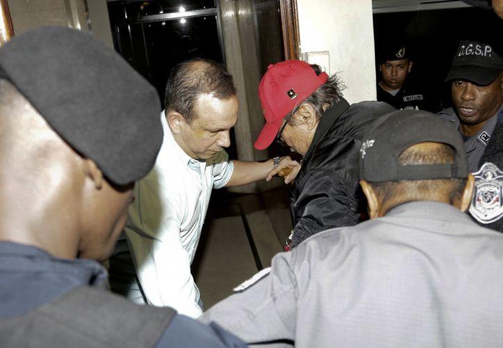 Noriega cumple 60 años de prisión por diversos delitos. (AP/Arnulfo Franco)
