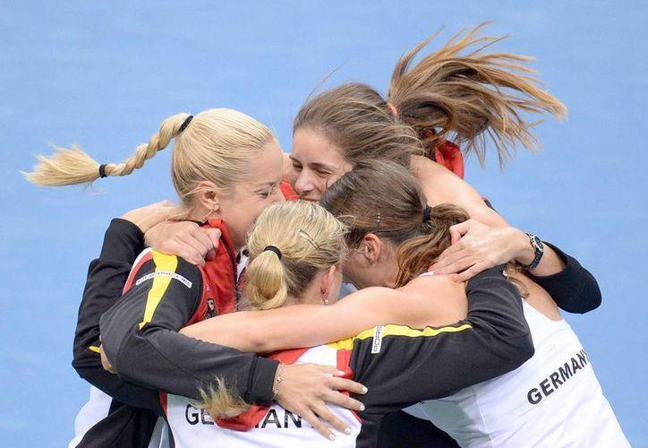 Las jugadoras galas festejaron su pase a la siguiente ronda tras derrotar a Australia. (Foto: EFE)