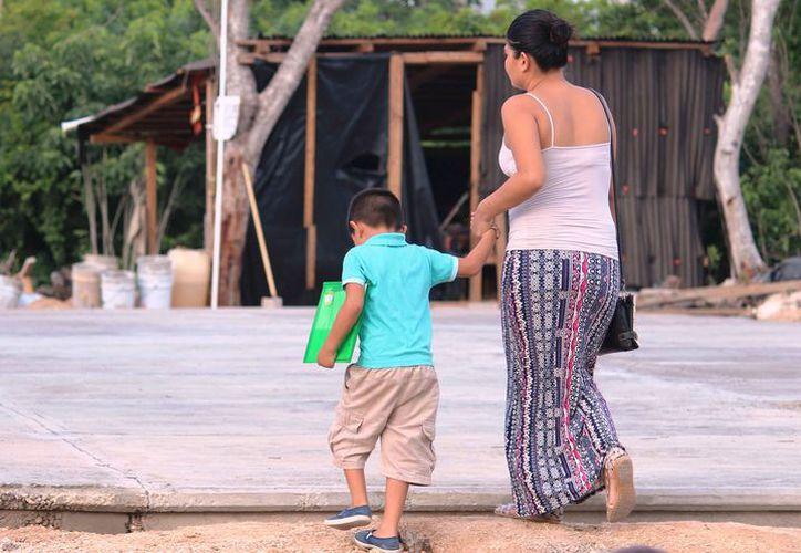 Las lluvias dejaron afectaciones en la salud de los menores. (Octavio Martínez/SIPSE)