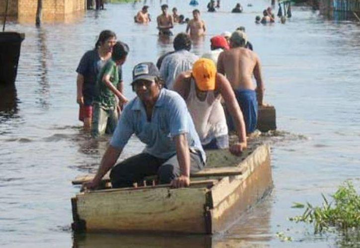 """El Gobierno declaró este  a Bolivia en """"emergencia nacional"""" debido a los desastres causados por lluvias, desbordamiento de ríos e inundaciones en las últimas semanas. (noticiassin.com)"""