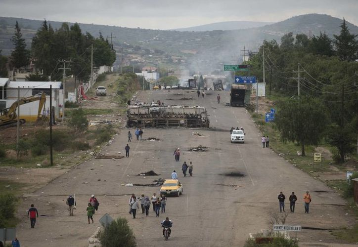 El enfrentamiento en Nochixtlán entre la Policía Federal e integrantes de la sección 22 de la CNTE dejó ocho muertos. (Agencias)