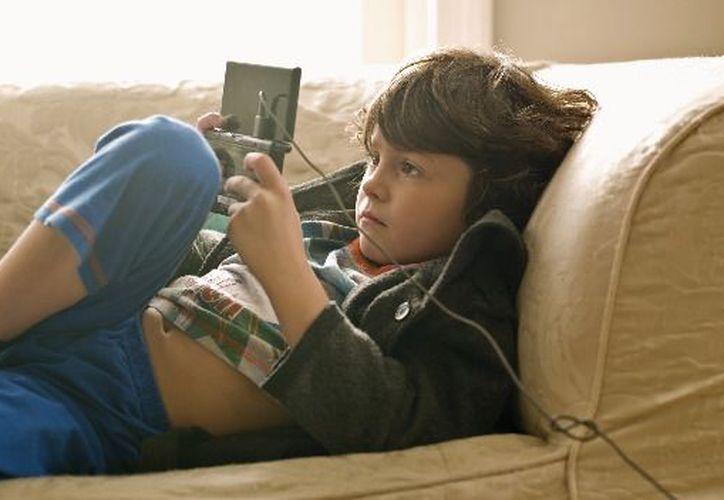 El 61 por ciento de los niños prefiere recibir como obsequio consolas de videojuegos y teléfonos celulares. (cnn.com)