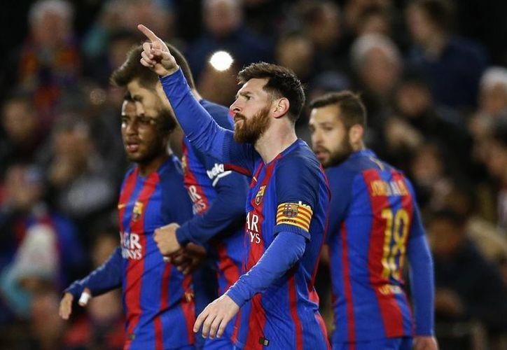 Barcelona se mantendrá una semana en el liderato de la Liga, pese a tener un partido más que el Real Madrid.(Manu Fernández/AP)