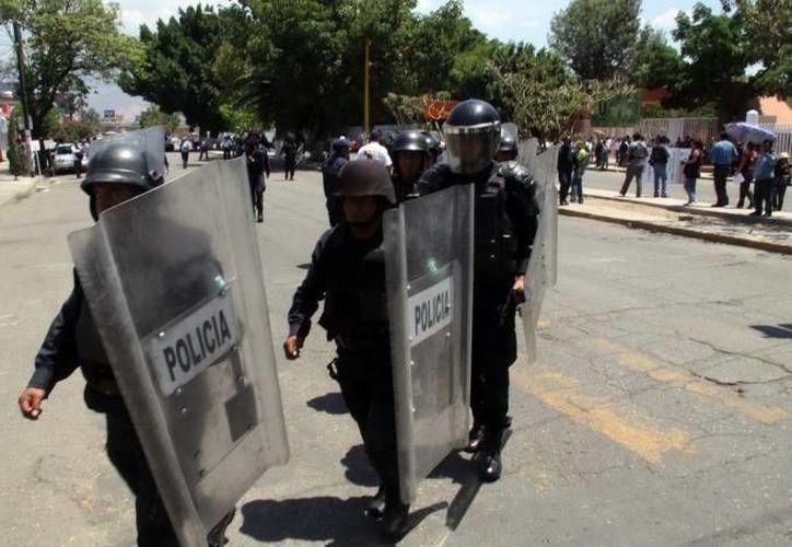 Un comando armado atacó con pistolas nueve milímetros y 38 súper un negocio en Acapulco. (Notimex/Foto de contexto)