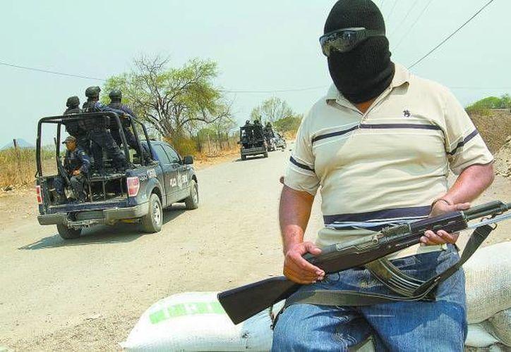 Documentos de seguridad nacional revelan la existencia de 'La Tercera Hermandad' o 'Los H3' en Michoacán. En la gráfica se aprecian autodefensas. (Milenio/Foto de contexto)